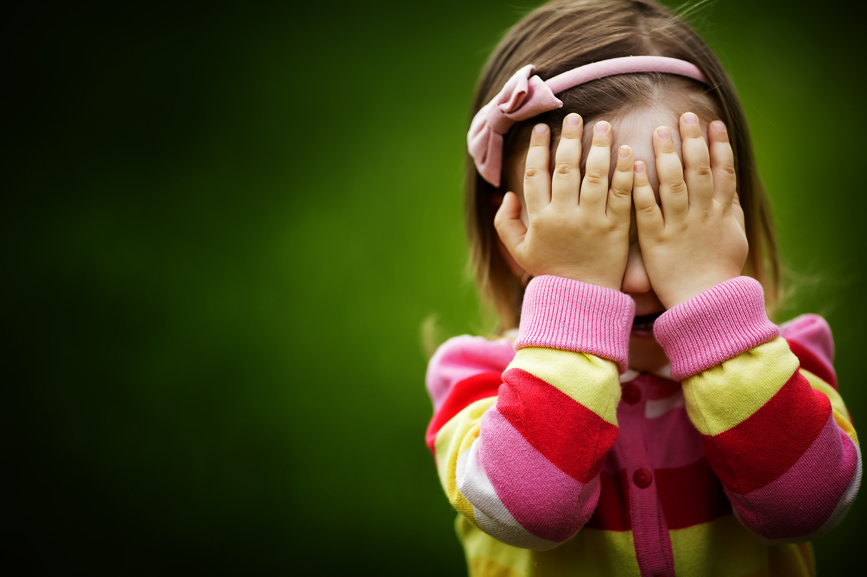 little girl hiding hide and seek
