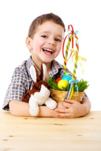 boy playing with easter toys